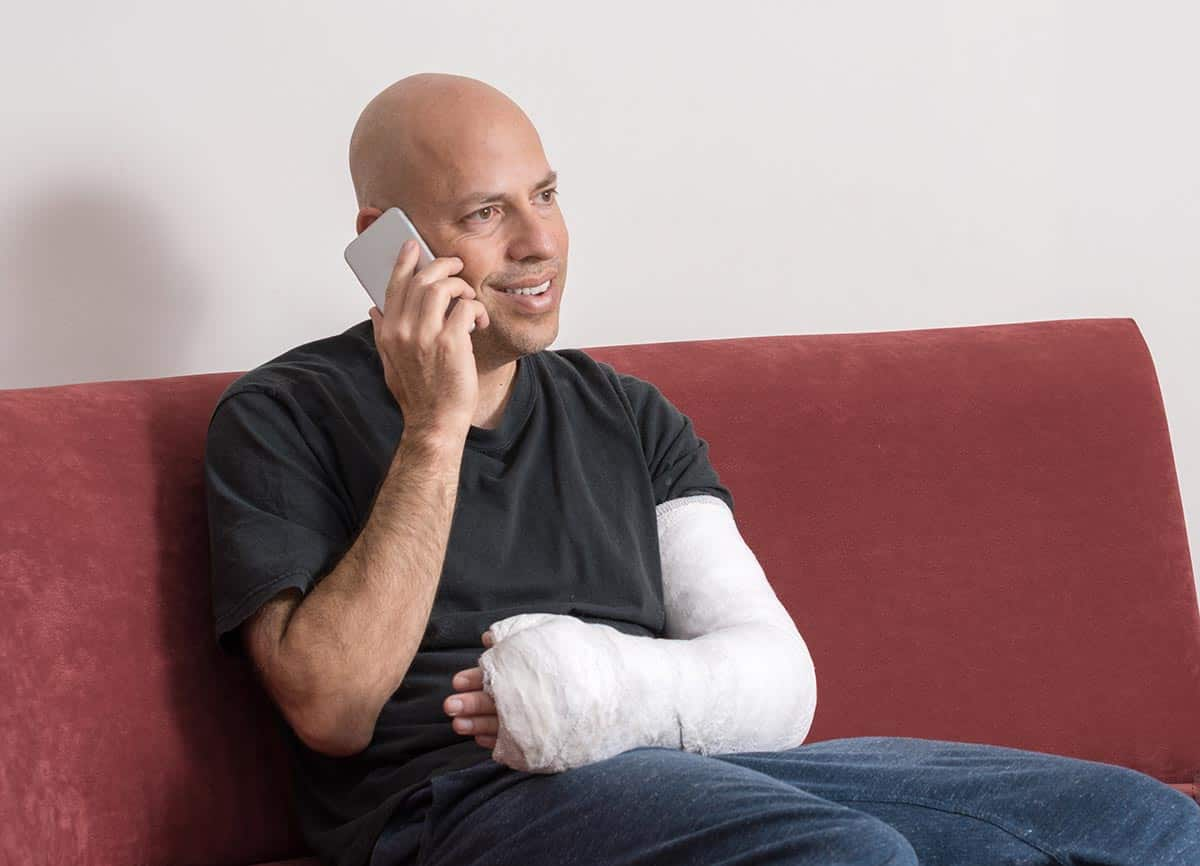 Injured man speaking with his Personal Injury Lawyer in Pennsylvania over the phone