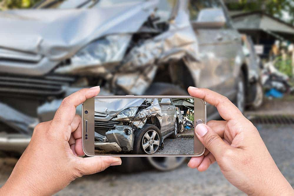 Person taking a photo of a car accident for their Car Accident Lawyer in Pennsylvania